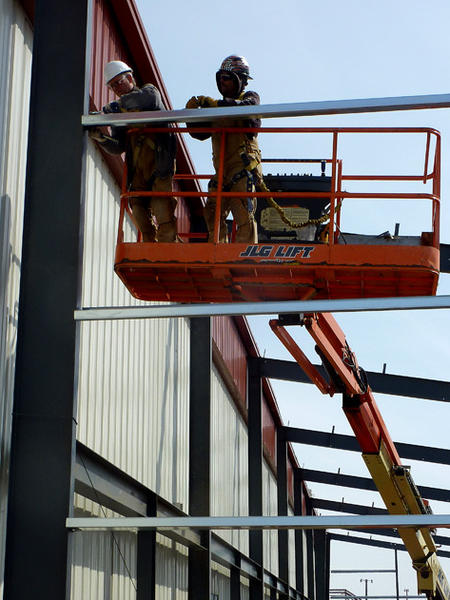 James Anderson, left, and Kevin Bakke of Steel Structure of Aberdeen do steelwork on the south side of the Odde Ice Center. An expansion is being added to the building.