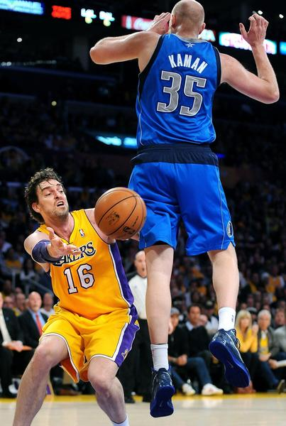 Lakers forward Pau Gasol passes around Dallas Mavericks big man Chris Kaman in Tuesday's victory.