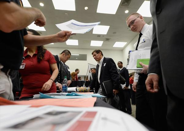 Veterans peruse employment openings at a job fair last month in Los Angeles.