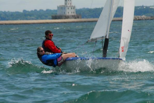 Andy Camarda, assisted by Markell Pool, sails in Milwaukee last year.
