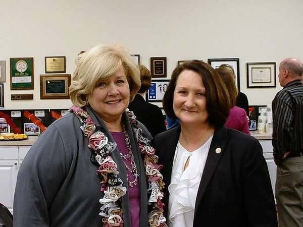 Homer Glen Village Trustee Mary Niemiec, right, was honored at a reception last week by officials including state Rep. Renee Kosel, left. Niemiec has served on the board since the village was incorporated and is not seeking re-election.