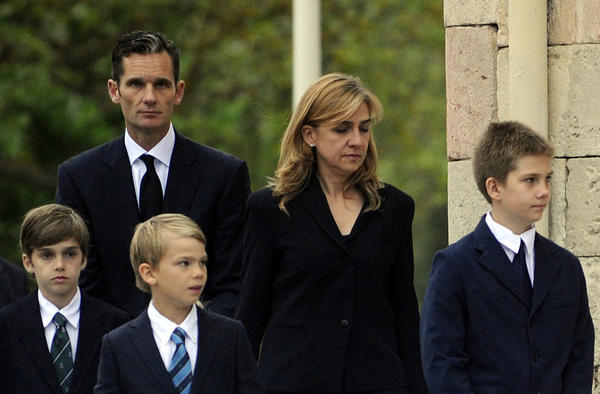 Spain's Princess Infanta Cristina, shown in May 2012, with her husband Iñaki Urdangarin and their children at the funeral of Urdangarin's father. The princess has been summoned to testify in a corruption case involving her husband.