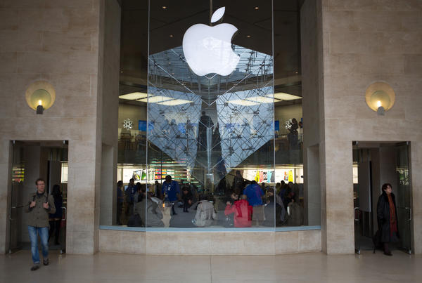 Customers such as these at the Apple store in Paris might have to wait longer than usual for the release of devices running Apple's next mobile platform, iOS 7.