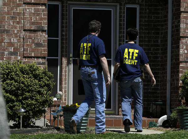 Agents from the federal Bureau of Alcohol, Tobacco, Firearms and Explosives enter the home of Kaufman County, Texas, Dist. Atty. Mike McLelland on Monday as the investigation into the slayings of McLelland and his wife continues.