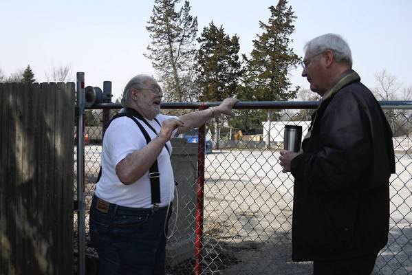 Glenview resident Howard Schraeder, left, and Village Board Trustee Philip White stand in front of a possible future temporary fire station site, discussing nearby residents' concerns on March 30.