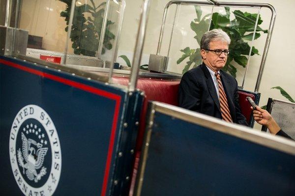 Sen. Tom Coburn, R-Okla., rides the Senate subway on his way to the Capitol.