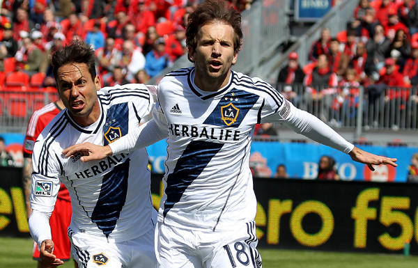 Galaxy forward Mike Magee (18) celebrates a goal with teammate Marcelo Sarvas in an MLS game against Toronto FC on Saturday.
