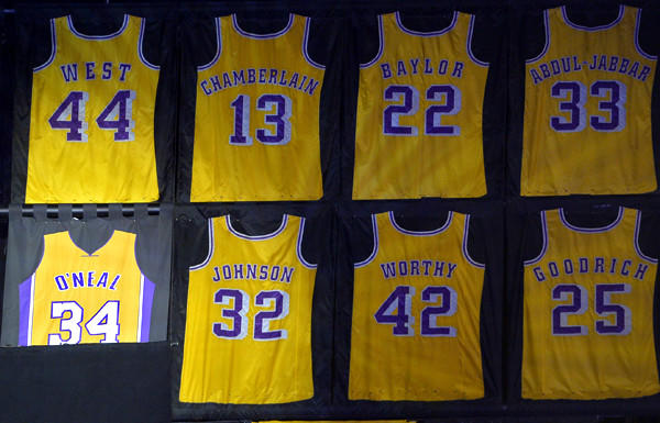 The No. 34 jersey of former Lakers center Shaquille O'Neal is unveiled Tuesday with the V-neck front.