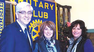 District Gov. Jim Eberly recently attended a meeting of the Rotary Club of Hancock to honor the club with several awards based on the giving levels that the Hancock club made to the Rotary Foundation.