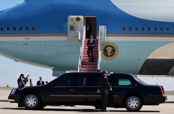 President Obama disembarks from Air Force One at Buckley Air Force Base in Denver. After his Colorado visit, he was to head to the San Francisco Bay Area.