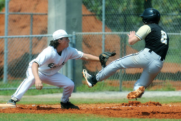 Atlantic High third baseman attempts to tag out Olympic Heights Bryan Greff. Atlantic has won 13 of its last 14 games. Photo/Scott Fisher