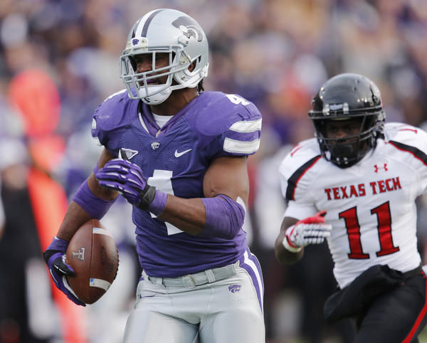 Kansas State Wildcats linebacker Arthur Brown sprints down field after intercepting Texas Tech quarterback Seth Doege last season.