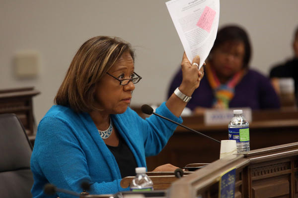 Schools CEO Barbara Byrd-Bennett responds to a student speaking at the board meeting.