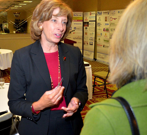 Kathy Snyder, president and chief executive officer of the Maryland Chamber of Commerce, chats Wednesday with Karen Pelton of Fahrney-Keedy Home and Village following the Hagerstown-Washington County Chamber of Commerce's Eggs and Issues breakfast at the Ramada Plaza.