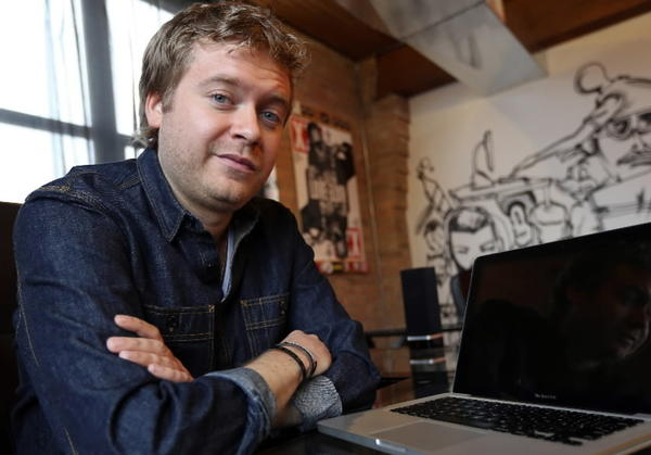 Andrew Barber is seen in Chicago in the office of Fake Shore Drive, his website that covers hip-hop music and culture.