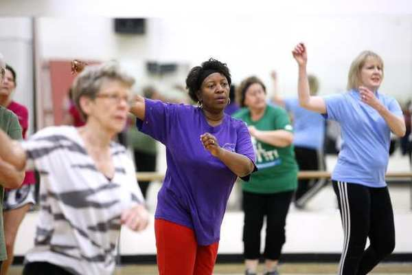 "Cynthia Roye of La Caada, center, gets moving in the ""50 Moving Forward"" low impact class at the Crescenta-Caada Family YMCA in La Caada Flintridge on Tuesday, April 2, 2013. The class is geared for adults 50 and older and they do not have to be members of the Y."