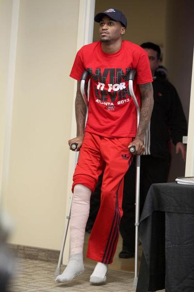 Louisville basketball player Kevin Ware arrives at a press conference at the KFC Yum! Center practice facility Wednesday.