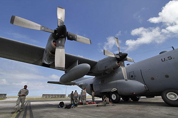Members of the 374th Airlift Wing of the U.S. Air Force work on a C-130 aircraft in February during military exercises at Andersen Air Force Base on Guam.