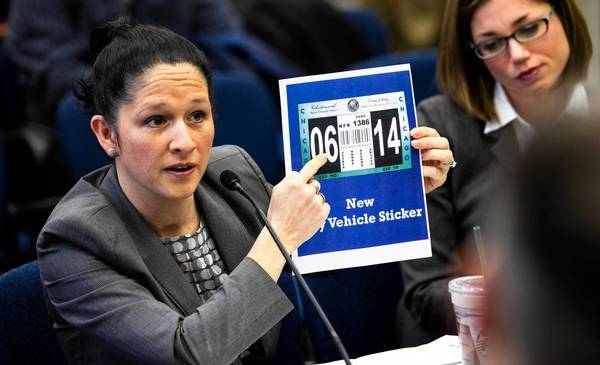 City Clerk Susana Mendoza presents a new city vehicle sticker to aldermen on the Committee on License and Consumer Protection at City Hall on Wednesday.