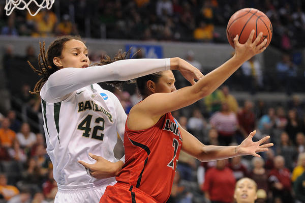 Baylor's Britteny Griner blocks the shot of Louisville's Bria Smith.