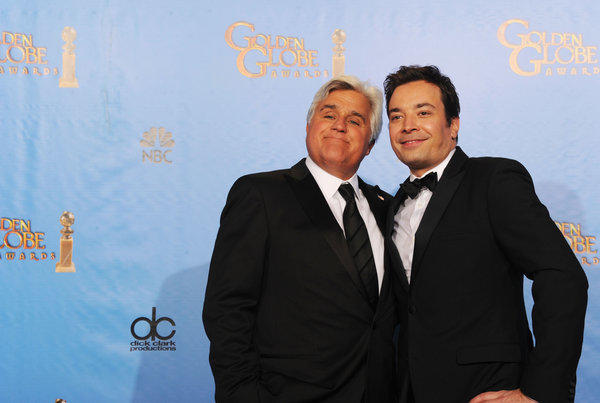 Presenters Jay Leno, left, and Jimmy Fallon pose in the press room during the 70th Annual Golden Globe Awards at the Beverly Hilton Hotel in Beverly Hills.
