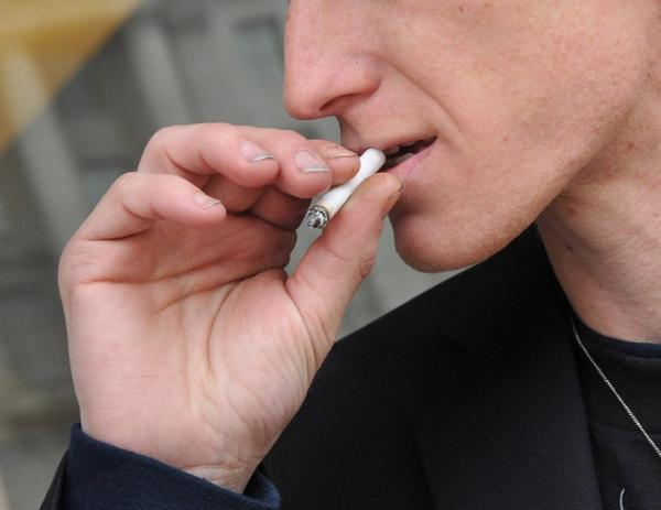 A small but growing number of employers are looking for job applicants who don't smoke.