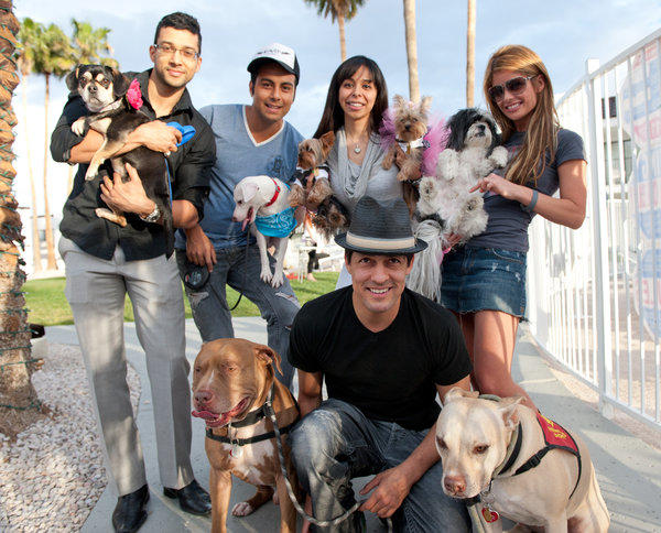 Dogs and their owners pose for a group photo during Yappy Hour, a unique cocktail party in Las Vegas.