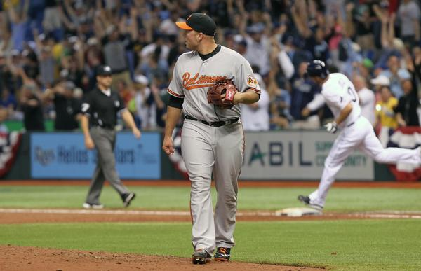 Orioles pitcher Tommy Hunter reacts after giving up the game-winning homer in the bottom of the ninth.