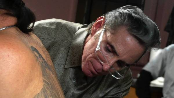 "Tattoo artist Mark Mahoney works on Danny Trejos' back in ""Tattoo Nation."""