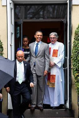 The Rev. Luis Leon, right, looks on as President Obama leaves St. John's Episcopal Church after an Easter service in Washington, D.C.