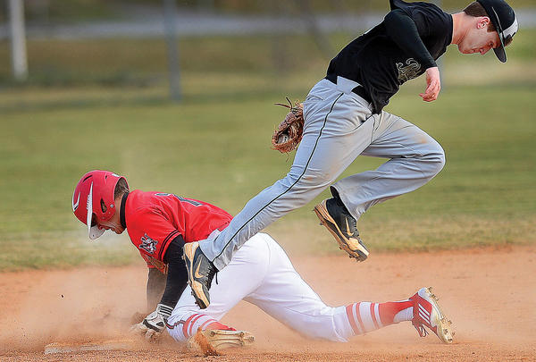 North Hagerstown's Mark Grunberg, left, is safe at second base as South Hagerstown shortstop Colby Johnson tries to make a play Wednesday at South.
