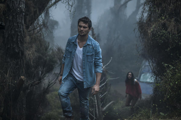 "Shiloh Fernandez, left, and Jessica Lucas in TriStar Pictures' horror, ""Evil Dead."""