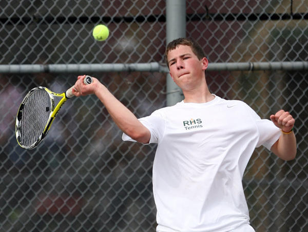 Aberdeen Roncalli's Adam Goetz watches the ball as he returns a volley during his singles match with Watertown's Mark DeSpiegler Tuesday at the Northern State University Courts. photo by john davis taken 5/1/2012