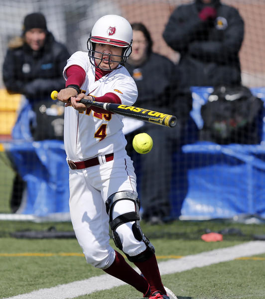Northern State University's Caitlin Moran connects with a pitch as she lays down a hit against the University of Minnesota-Duluth during Wednesday's first game at Swisher Field. photo by john davis taken 4/3/2013