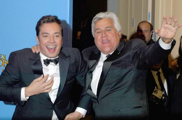 Jay Leno and Jimmy Fallon sharing a light moment at the 2013 Golden Globe Awards.
