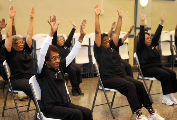 "Shirley Daley, front left, participates in the ""Praisercise"" exercise class at Calvary Baptist Church."