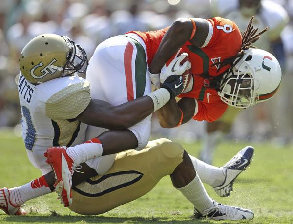 Georgia Tech outside linebacker Brandon Watts (11) tackles University of Miami wide receiver Malcolm Lewis. Lewis was injured on the play and did not return to the game.
