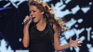 "Rock-and-roll night on ""<a href=""http://www.americanidol.com"" target=""_blank"">American Idol</a>"" rolled to the top of the Wednesday ratings in total viewers. Yet ABC's ""Modern Family"" was the No. 1 show with young adults."