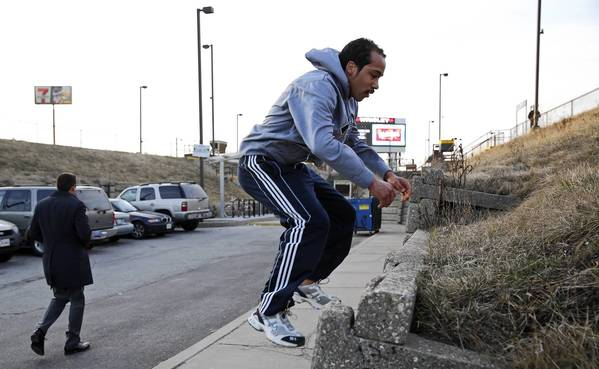 A.J. Lupie leaps onto a sidewalk barrier at the Metra Clybourn station during a morning workout. Lupie, 26, is training to compete in the USA Judo Senior National Championships in Virginia Beach, Va., next week. He has competed in the sport since he was 13.