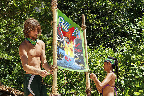 "Erik Reichenbach and Brenda Lowe hang up their new tribe flag during ""Blindside Time."""