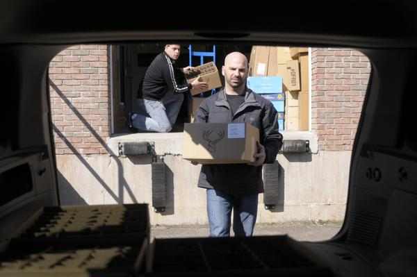 Delta Arsenal owner Douglas Odishoo of Wallingford loads his vehicle with 300 serial receivers for the high capacity AR-15 at Stag Arms in New Britain in an attempt to beat the noon deadline for selling the AR-15 in Connecticut.