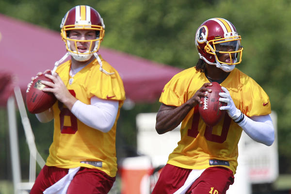 Washington Redskins quarterbacks Robert Griffin III (right) and Rex Grossman during 2012 training camp.