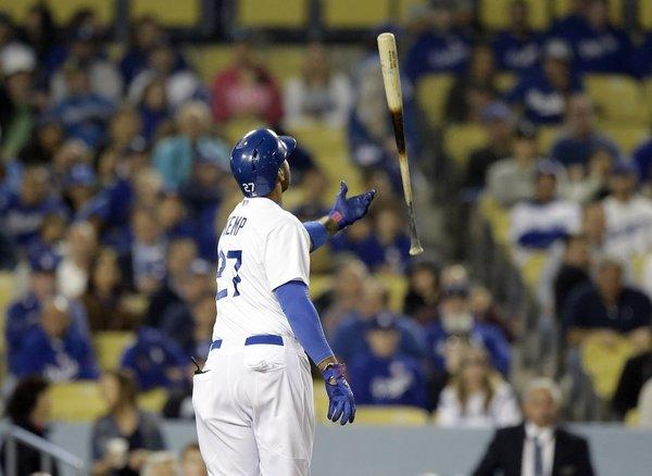 Matt Kemp tosses his bat after striking out Wednesday against the San Francisco Giants.