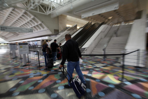 Passengers head to their gates at LA/Ontario International Airport.