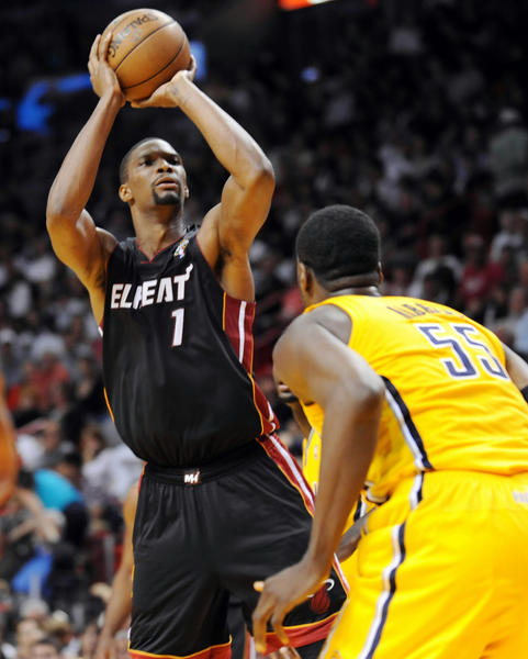 Chris Bosh, of the Miami Heat, goes up for a shot in the first half against the Indiana Pacers at the AmericanAirlines Arena in Miami on March 10.