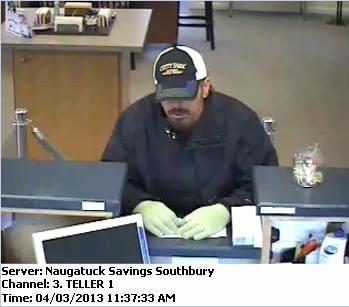 State Police are investigating a robbery that took place at the Naugatuck Savings Bank on Main Street South in Southbury on Wednesday, April 3, 2013.