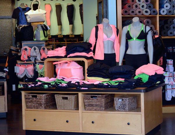 RBC Capital Markets downgraded Lululemon's stock after the athletic clothing maker said its chief product officer was leaving the company. Above, Lululemon apparel at a store in Pasadena last month.