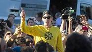 Lance Armstrong speaks to the crowd prior to a run with his fans at Mount Royal park in Montreal