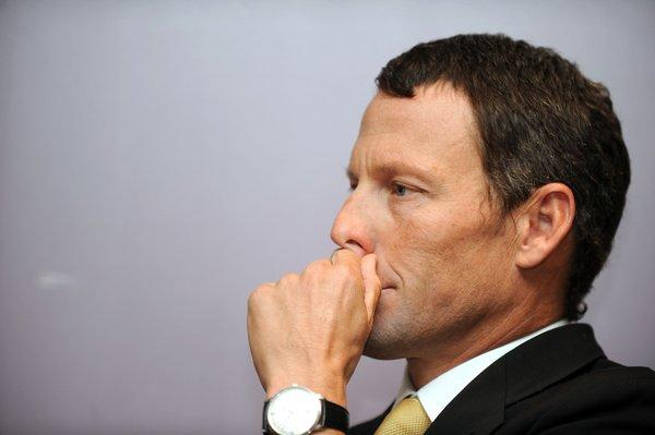 Lance Armstrong won't be participating in a swimming competition in Texas this weekend after the sports' international federation body objected.