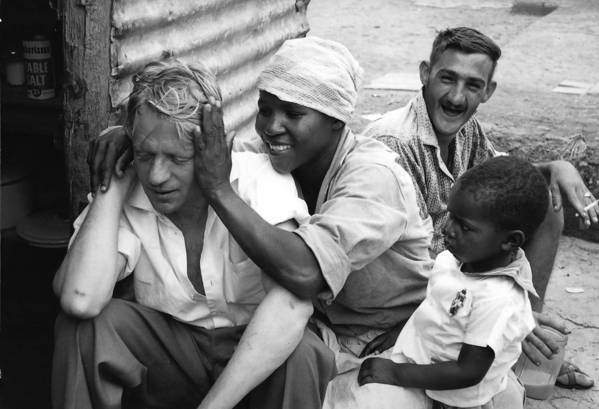 "An image from ""Ernest Cole: Photographer"" shows black and white people together in Pretoria, South Africa, though laws forbade some interactions."